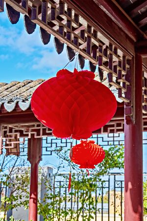 Traditional Chinese red lantern hanged in garden during celebrating Chinese New Year. China lantern festival concept