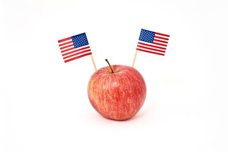 Red apple with two flags of USA isolated on white background. Greeting card to celebrate Happy Presidents Day, Flag Day of America, Labor Day or election Day, copy space Stock fotó