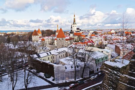 Cityscape of Old Town from high part of Toompea in Tallinn, Estonia on sunny winter day and cloudy sky. Famous landmark of modern Tallinn