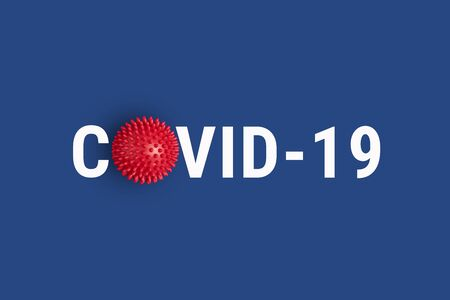 Inscription COVID-19 on blue background with red abstract virus strain model. World Health Organization WHO introduced new official name for Coronavirus disease named COVID-19