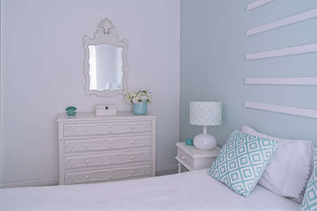 Shabby chic style mint pastel bedroom. Cozy bright and light bedroom with decor