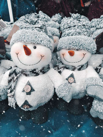 Cute small Christmas decorations toy snowman with smile, toned image 스톡 콘텐츠