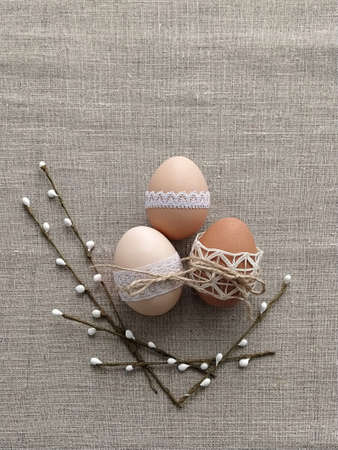 Easter composition decorated by lace Easter eggs on linen background. Plastic-free concept and zero waste