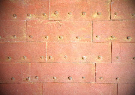 rivets: Rust steel metal texture with rivets background.