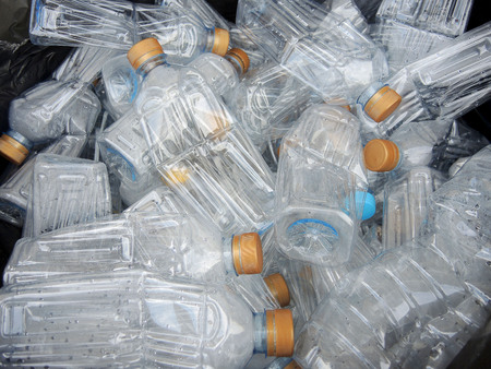 Recyclable garbage of plastic bottles in rubbish bin