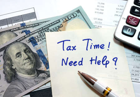 spread sheet: Tax time concept with money, spread sheet and calculator. Stock Photo