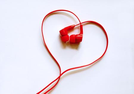 Headphones earphones red heart shape on white background   Love music