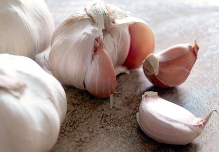 Garlic bulbs and cloves on wooden board, natural medicine, eat healthy food
