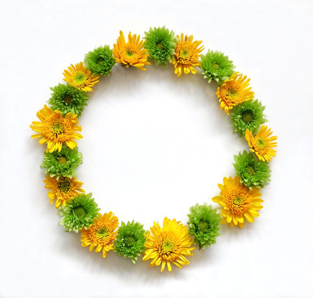round: Flower composition round frame wreath made of various yellow and green flowers on white background.  Flat lay, top view Stock Photo