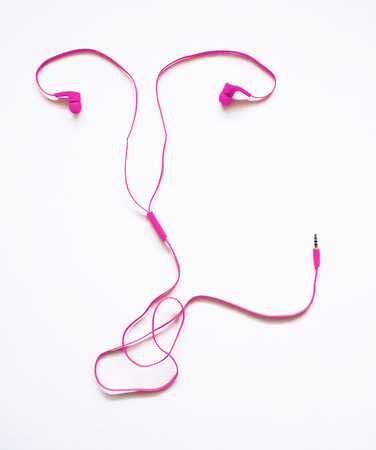 Headphones earphones pink uterus shape on white background. Listen to your body. Cancer which originate in a womans reproductive system.