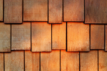 Abstract wooden texture of red cedar shingles, shake wood siding row roof panel.