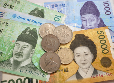 South Korean won banknote and coin as background. Finance business currency exchange concept.