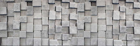 Wood aged art architecture texture abstract block stack on the wall for banner background. Standard-Bild
