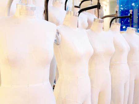 Female mannequins stand in row model pattern fashion industry. Standard-Bild