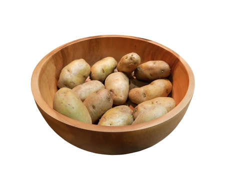 Fresh potatoes in wooden bowl isolated on white background.