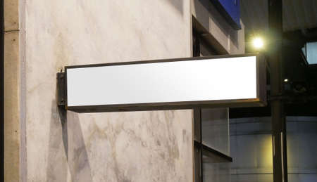 Blank store signboard mockup. Empty illuminated shop lightbox template mounted on the wall.
