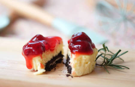 Mini cheesecake with chocolate cookies and berries sauce.