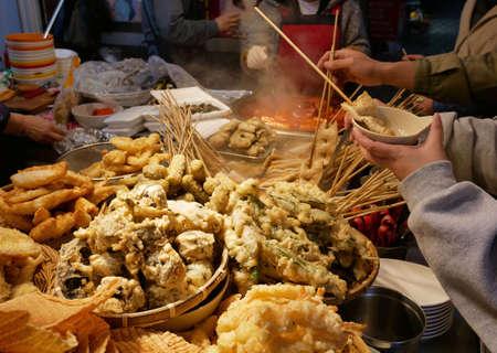 Korean street food stall, Odeng (fish-cake skewers), tteokbokki and other fried food.