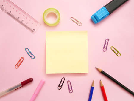 School office supplies on a desk with copy space. Back to school concept. Standard-Bild