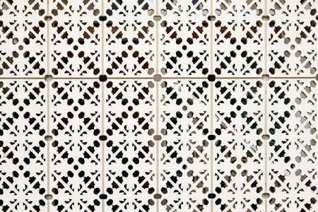 Wood carving with geometric pattern for home interior design elements, screens and room dividers.