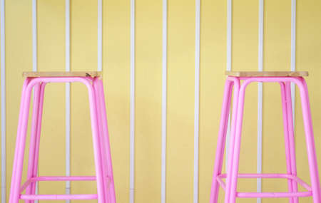 Pink chairs on a yellow pastel background. Minimal style concept. pastel color style. Banque d'images