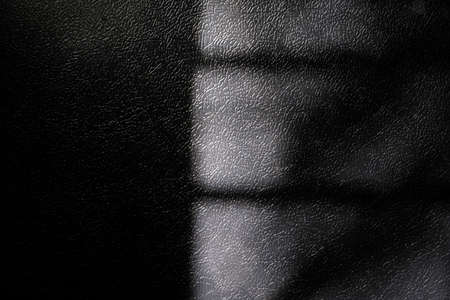 Window natural shadow on black leather texture background overlay effect for photo, mock up, product, wall art, design presentation
