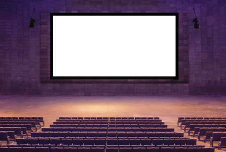 Cinema movie theater hall with empty seat and wide white screen Banque d'images