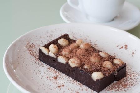 macadamia brownie on a white plate photo