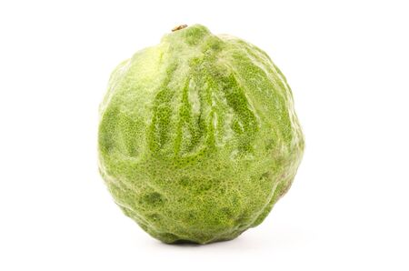 Fresh Kaffir Lime on white background photo