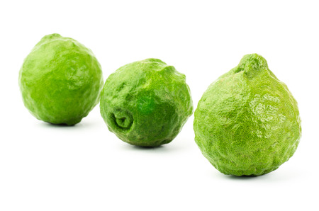 Fresh Kaffir Lime on white background photo