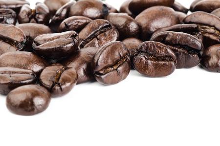 Roasted coffee bean on white background photo