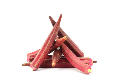 Red okra on white background
