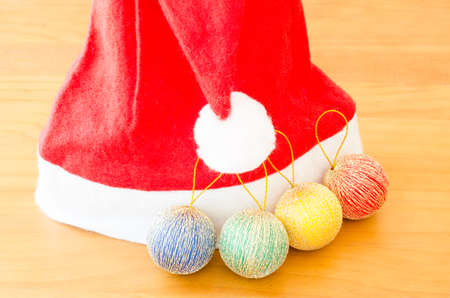 colorfu: Colorfu christmas ball and hat on wooden background Stock Photo