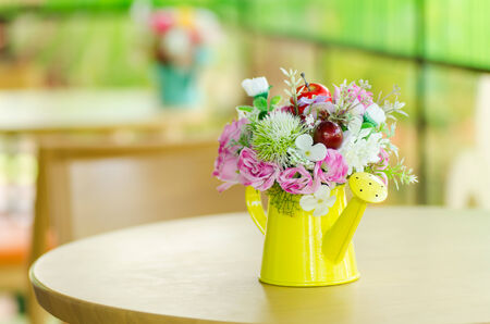 Decorative artificial flower in vase photo