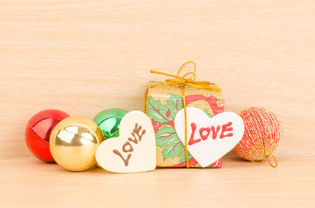 Gift box with love on wooden background photo