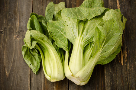 Organic Chinese cabbage ( Bok choy) on black wooden background Stock Photo