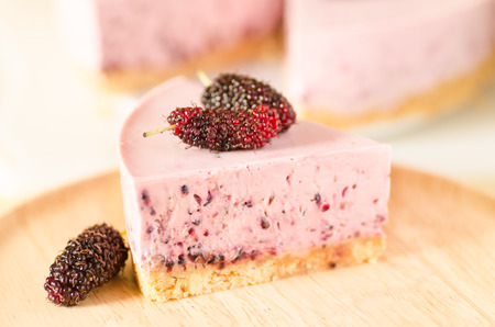 Mulberry cheesecake on wooden plate