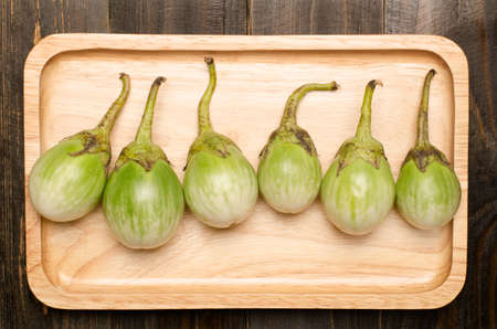 aubergine: Fresh Aubergine on wooden plate