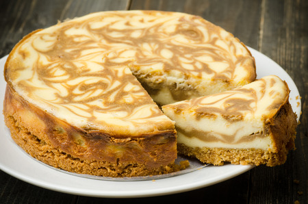 cheese slices: Homemade Coffee marble cheesecake on wooden background
