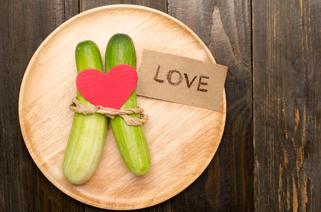 Couple cucumber with love on wooden plate, Clean eating Stock Photo