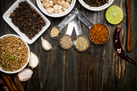 Herbs and spices, food seasoning on wooden background photo