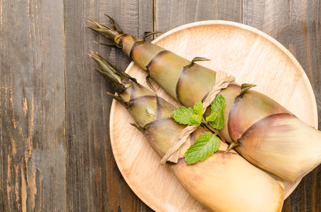Raw bamboo shoot on wooden plate, Clean eating Stock Photo