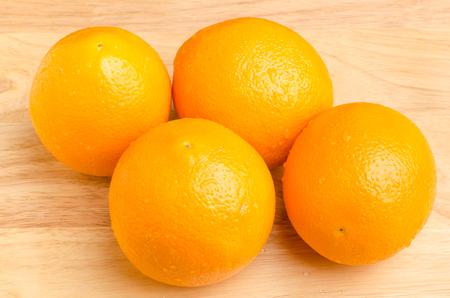 navel: Fresh Navel orange fruit on wooden background,healthy food