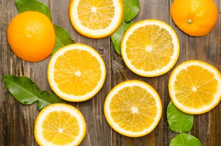 navel orange: Slices of fresh Navel orange fruit on wooden background,healthy food Stock Photo