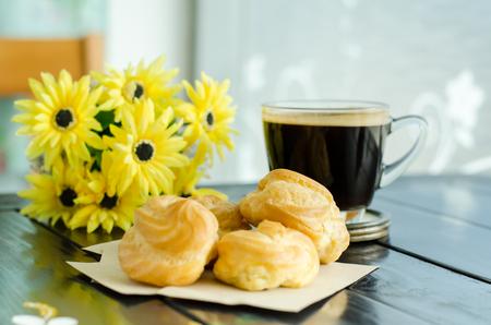 americano: Hot coffee (americano) and choux Stock Photo
