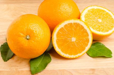navel: Slices of fresh Navel orange fruit on wooden background