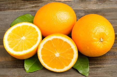 navel orange: Fresh Navel orange fruit on wooden background,healthy food