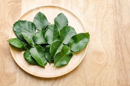 flavorful: Kaffir Lime (flavorful leaves) on wooden background