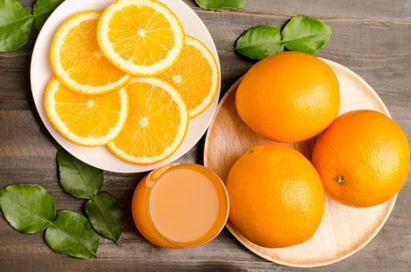 navel orange: Fresh Navel orange fruit,slices and juice on wooden background,healthy food