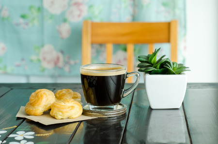americano: Hot coffee (americano) and choux,breakfast Stock Photo